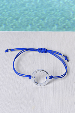 Bracelet with a rhodium plated ring and a Ocean blue rope