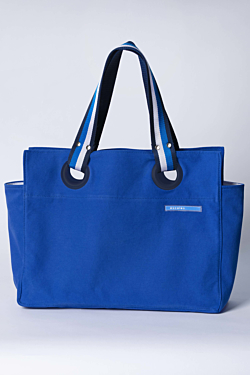 Blue beach bag in cotton with striped handle