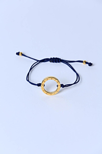 Bracelet with a Japanese cord and a gold-plated ring.