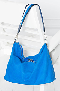 blue leather bag with a striped handle