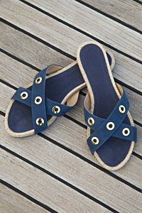 handmade leather flat sandals with natural sole and golden escales rings