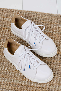 White sneakers woman. Leather trainers.