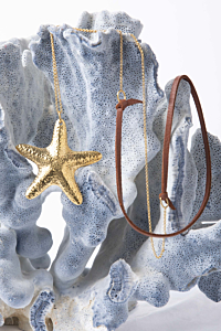gold plated sea stars necklace with leather detail
